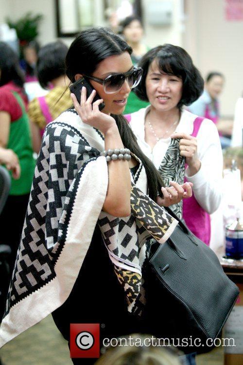 Kim Kardashian  talking on the phone at...