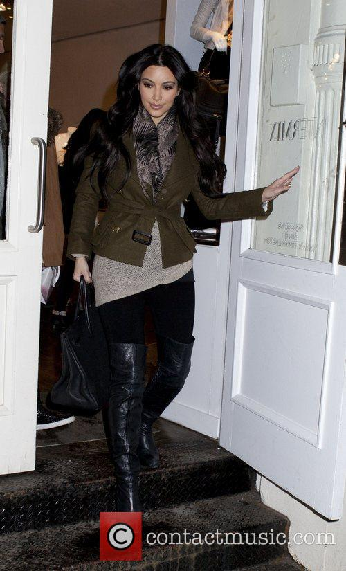 Leaving Intermix store in Soho wearing a brown...