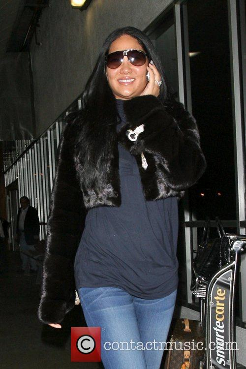 Kimora Lee Simmons talks on her phone as...