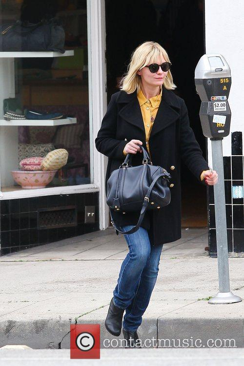 Kristen Dunst out Christmas shopping in Hollywood wearing...