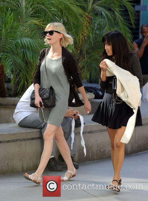Kirsten Dunst and a friend arrive at Arclight...