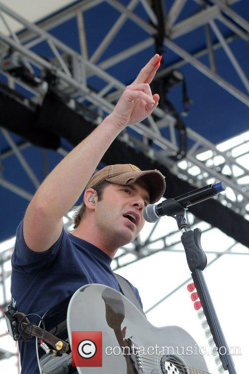 Rodney Atkins performs at the 25th Anniversary KISS...