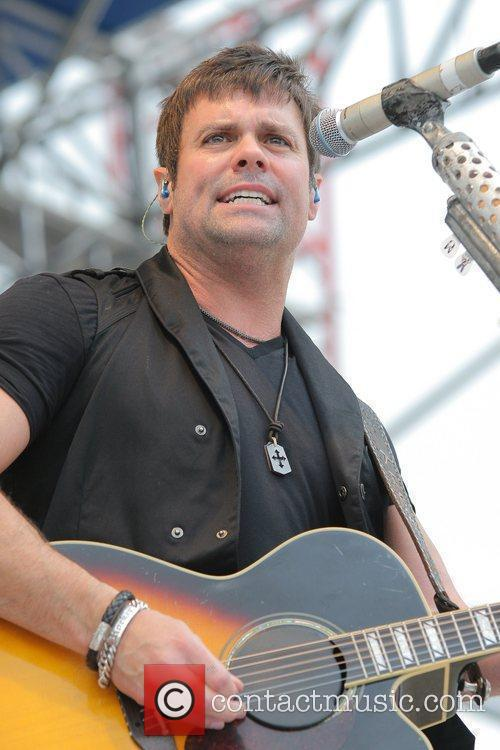 Troy Gentry performing at the 25th Anniversary KISS...