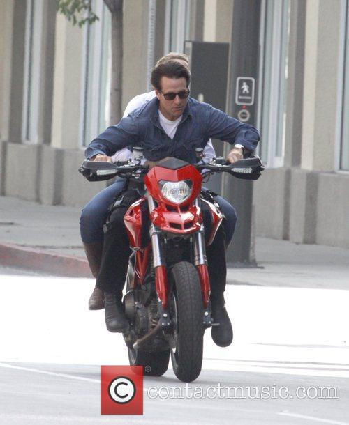 Riding a motorcycle while filming for 'Knight and...