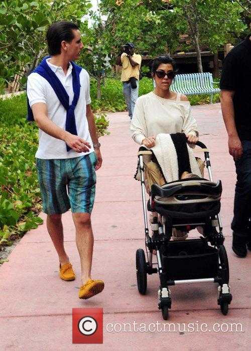 Take their son Mason Dash Disick for a...