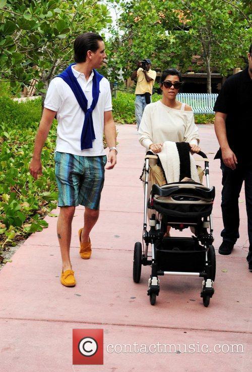 Kourtney Kardashian and Scott Disick take their son...