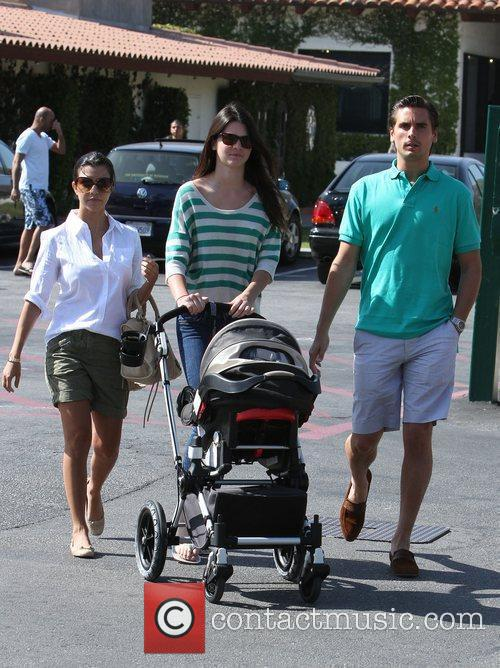 Kourtney Kardashian (L) and her partner Scott Disick...