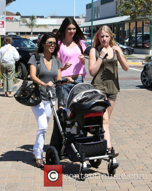 Kourtney Kardashian, Kendall Jenner and a family friend...