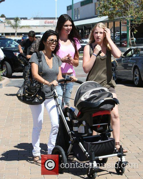 Kourtney Kardashian, Kendall Jenner (C) and a family...