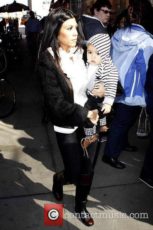 Kourtney Kardashian leaving her hotel with her baby...