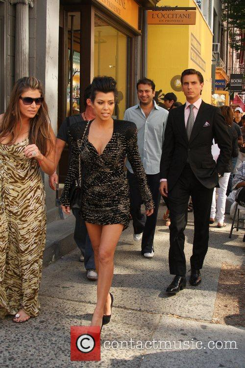 Kourtney Kardashian and her husband Scott Disick shop...