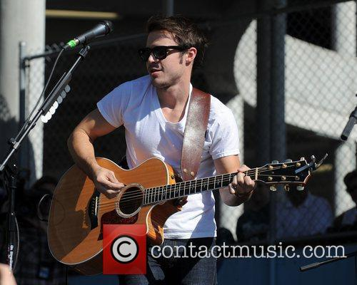 Kris Allen performs on the Landshark Tailgate stage...