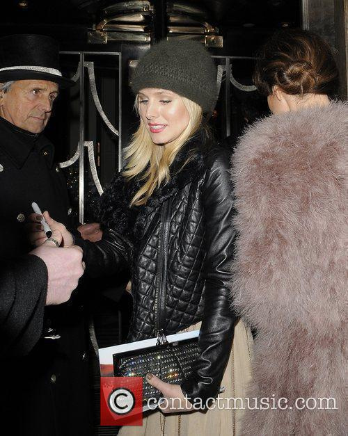 Actress Kristen Bell arriving back at her hotel...