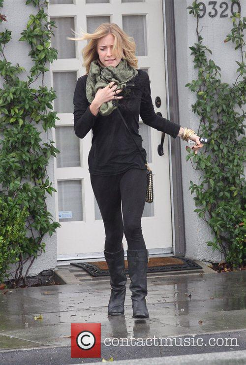 Kristin Cavallari braves the rain as she leaves...