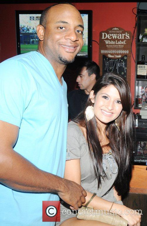 Ben Franciso and Cindy Lopez Kyle Kendrick celebrates...