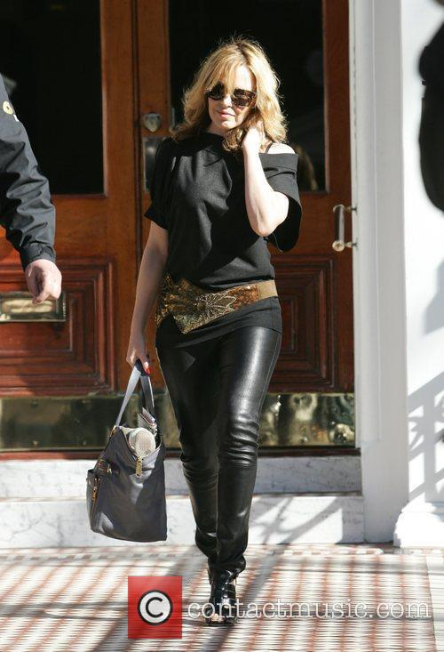 Kylie Minogue leaving her house in black leather...