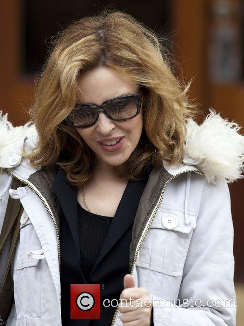 Kylie Minogue leaving her house to go to...