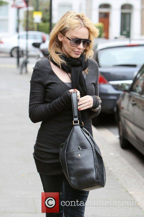 Kylie Minogue leaving the offices of her management...