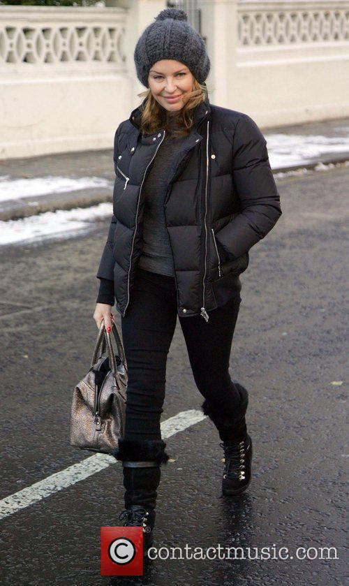 Kylie Minogue Leaving her home wrapped up warm...