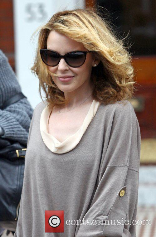 Kylie Minogue leaving her apartment to head to...