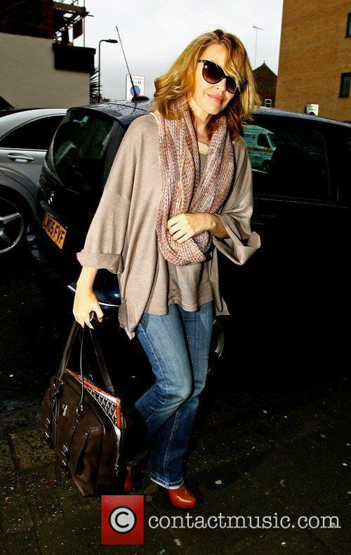 Kylie Minogue arriving at an office building for...