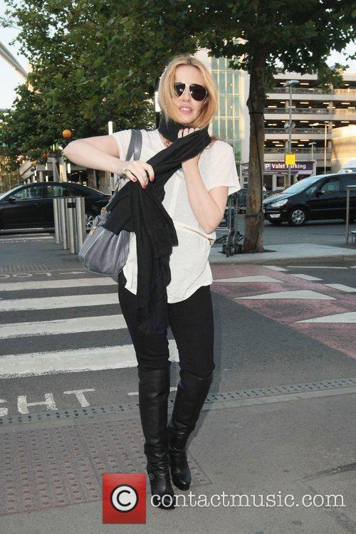 Kylie Minogue arriving at London's Heathrow Airport to...