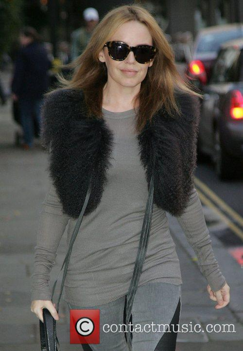 Leaving her house in London