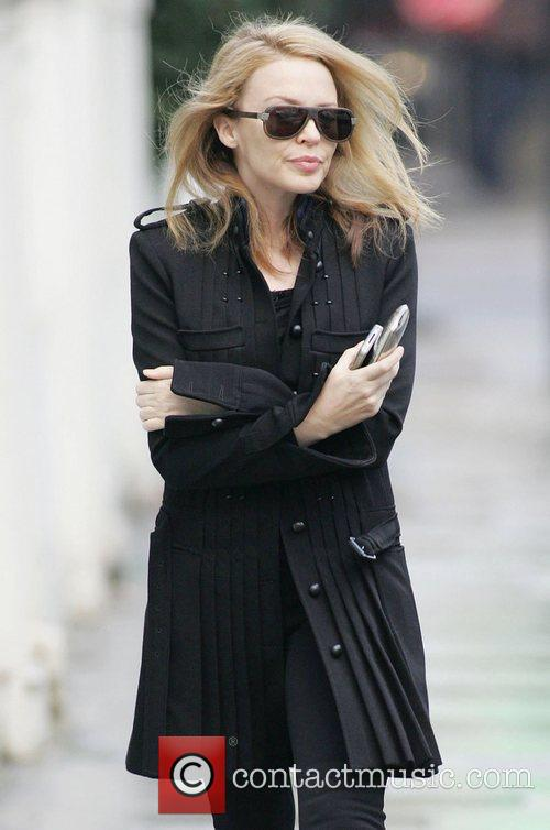 Kylie Minogue wearing dark sunglasses out and about...