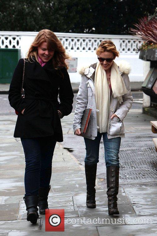 Kylie Minogue takes a walk with a friend...
