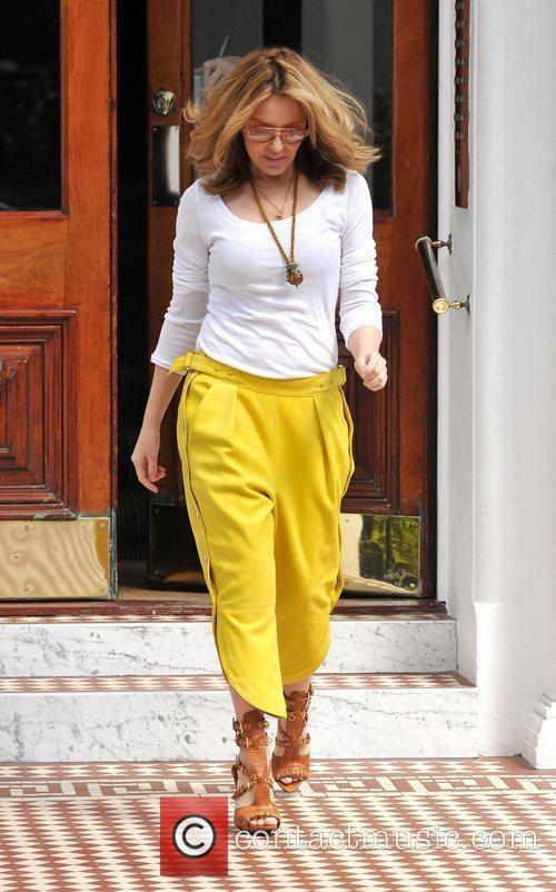 Kylie Minogue  leaving her home wearing mustard...