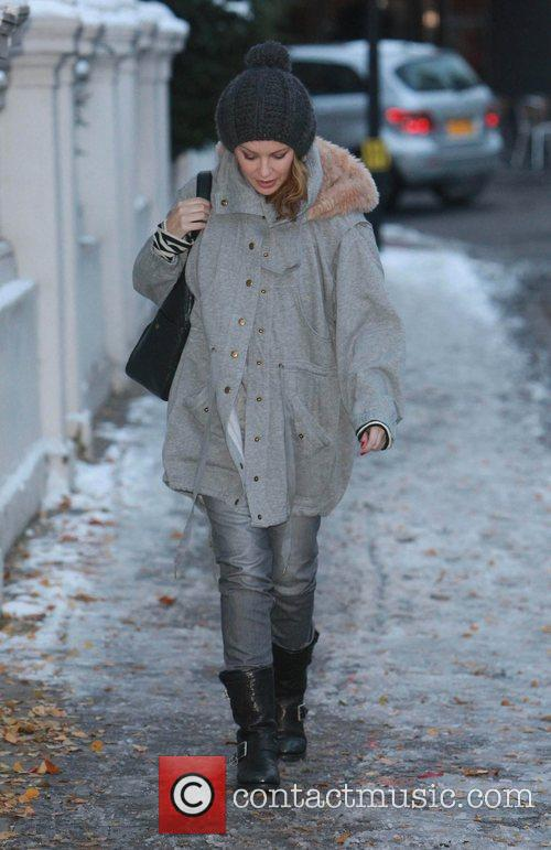 Kylie Minogue braves the cold weather and walks...