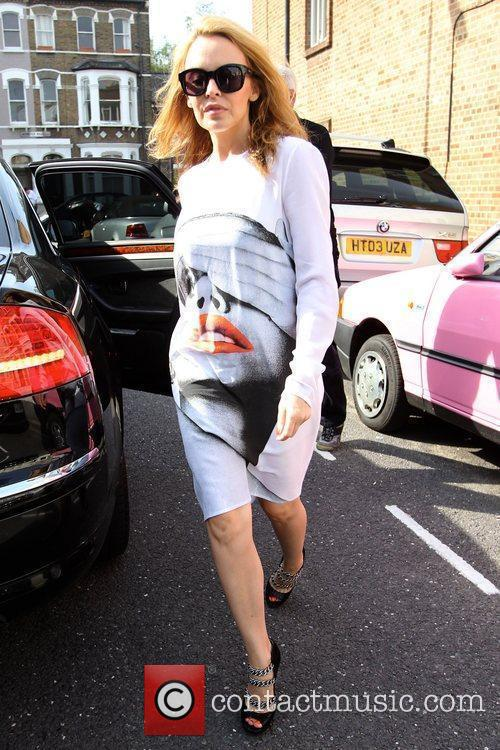 Kylie Minogue wearing a striking graphic print dress...