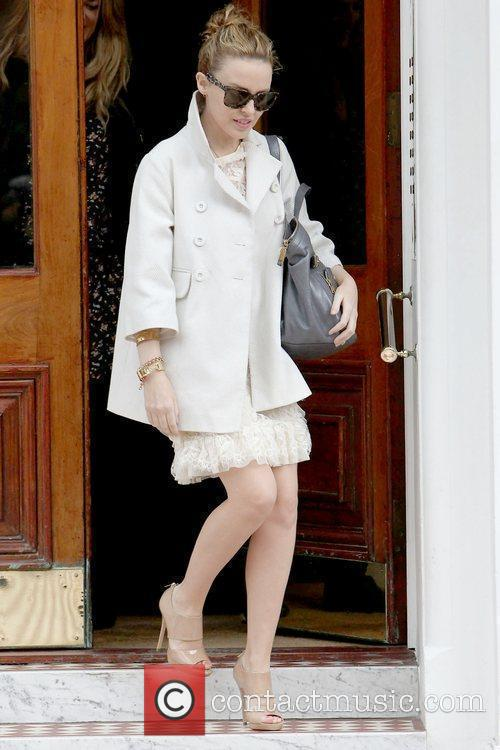 Leaving her home in a white, lace dress