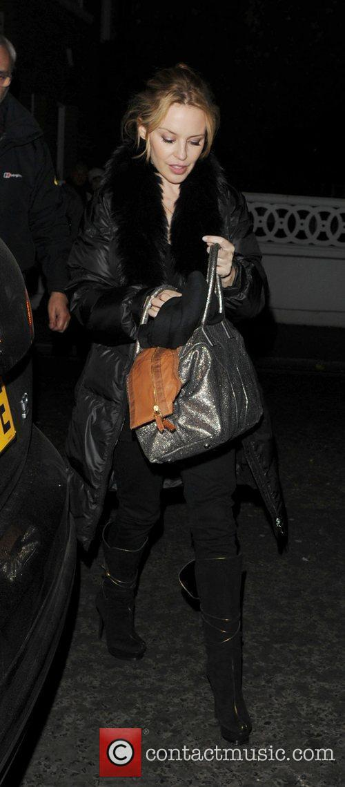 Kylie Minogue arrives at her home after spending...