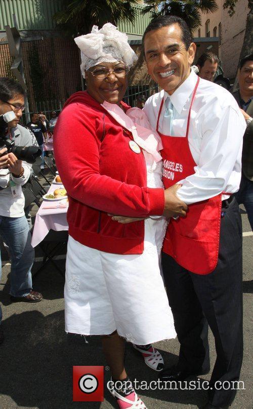 Los Angeles Mayor Antonio Villaraigosa hugs a homeless...