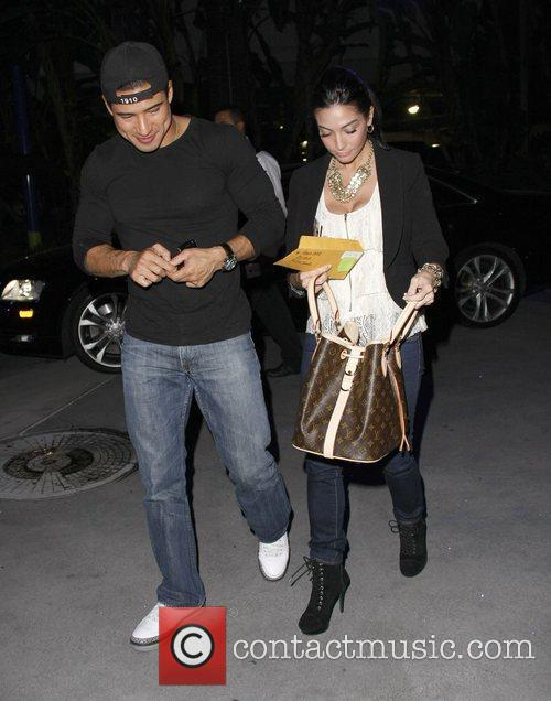 Mario Lopez and Courtney Mazza leave the Staples...