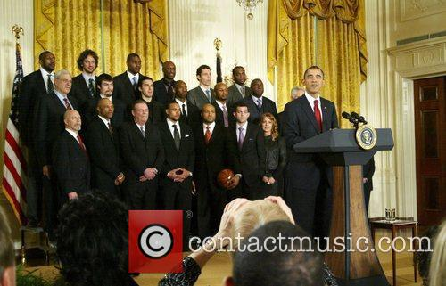 Avid basketball fan President Barack Obama  welcomed...