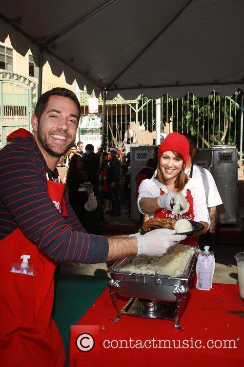 Zach Levi and Alyssa Milano Celebrities volunteer on...