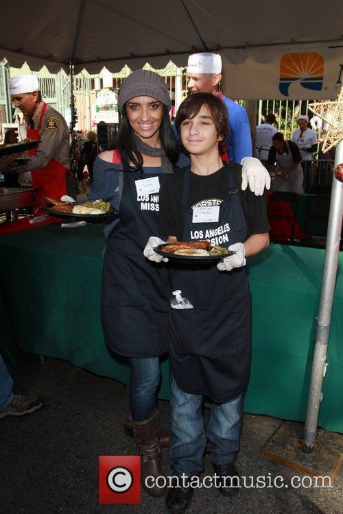 Carole Marini and George Marini Celebrities volunteer on...