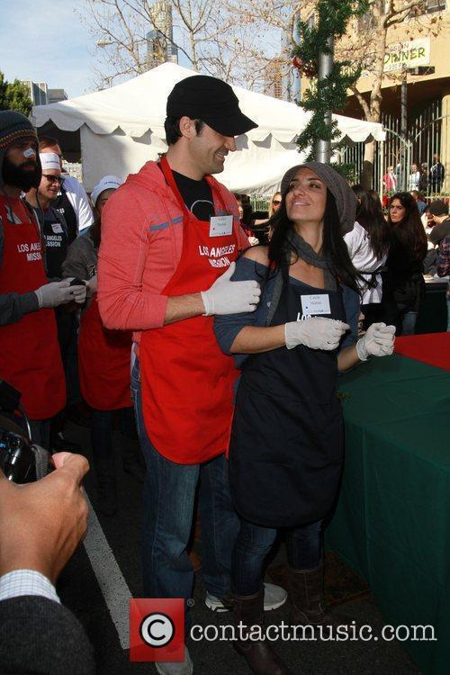 Gilles and Carole Marini Celebrities volunteer on Christmas...