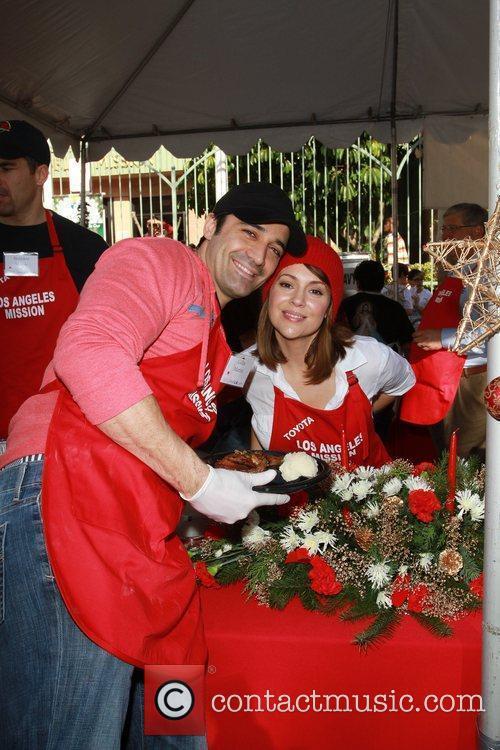 Gilles Marini and Alyssa Milano Celebrities volunteer on...