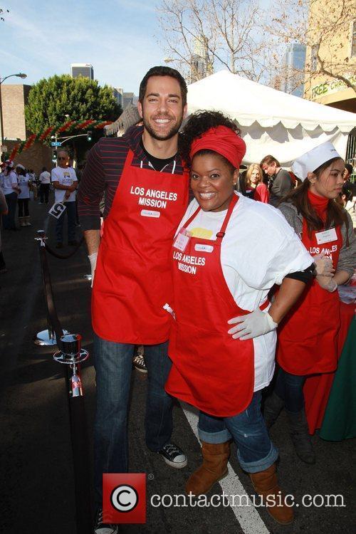 Zach Levi and Yvette Brown Celebrities volunteer on...