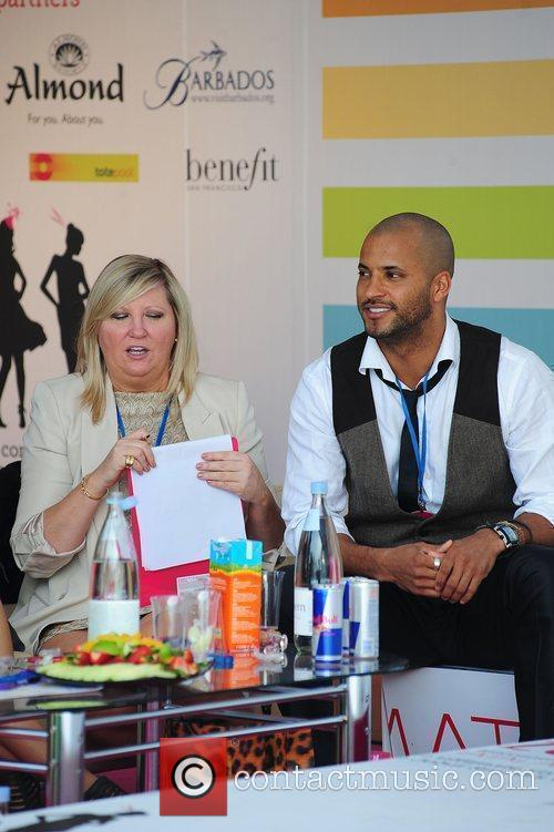 Ricky Whittle watching the racing from a private...