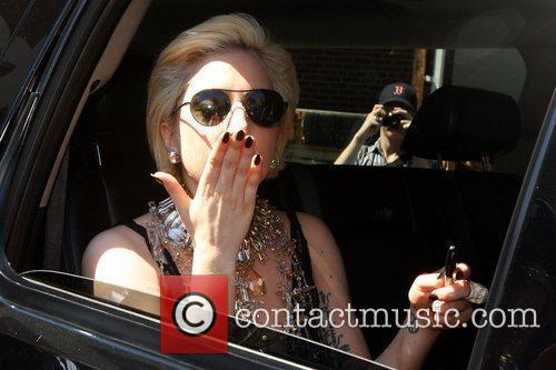 Lady Gaga signs autographs as she leaves MIT...