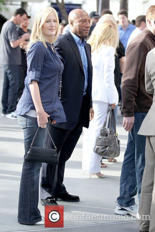 Jennifer Lucas and Byron Allen outside the Staples...