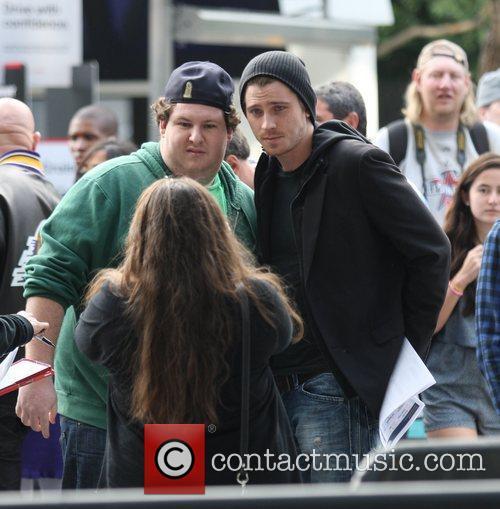 Garrett Hedlund and friend Celebrities arrive for the...
