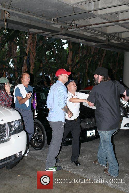 Brian Austin Green confronts a videographer that gets...