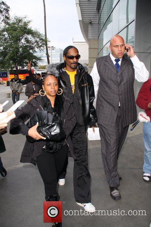 Snoop Dogg and his wife Celebrities arrive for...