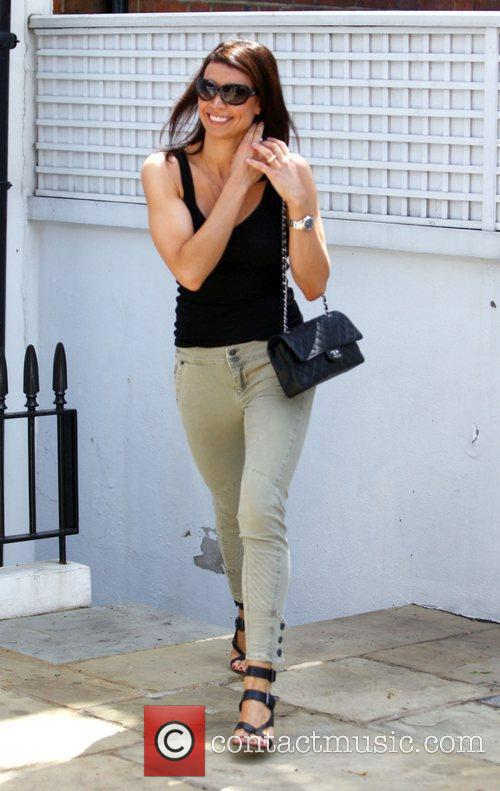Leaves boyfriend Frank Lampard's house with a very...