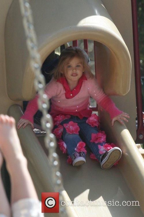 Playing at a park with her father